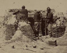 Union picket line soldiers posing behind gaboon defenses at fort Mahone, Virginia 1865.