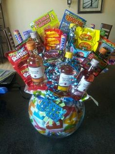 Wine and candy bouquet :) | relay for life ideas Alcohol Bouquet, Liquor Bouquet