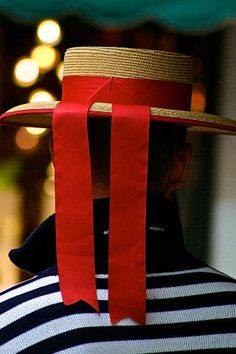 The quintessential gondolier immediately recognized by his striped shirt and classic hat.