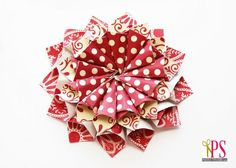 rolled paper flower christmas ornaments made from small scrapbooking paper cut into squares and folded - tutorial 2