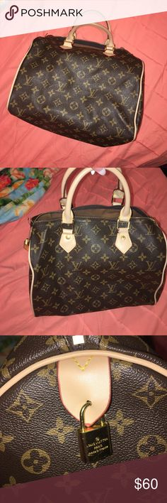 Louis Vuitton handbag Medium size Louis Vuitton handbag. I got this in New York off of the street not sure if it is authentic or not but it is in pretty good condition and has held up very nicely. Bags Satchels
