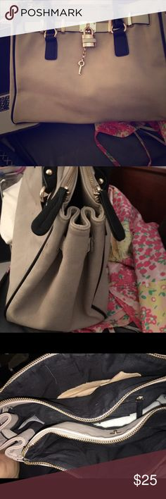 Aldo large taupe bag black piping and lock&key Large also purse carried a few times still in great condition. Taupe tan/grey color with black piping, and handles with gold hardware very cute and convenient. 3 large pockets inside two zip one clasps lots of storage and organizing pockets. Aldo Bags Shoulder Bags