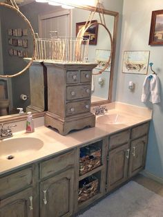 We gave our oak bathroom vanity cabinets a makeover with Annie Sloan Chalk paint in Country Gray, added some distressing and Dark Wax. We also added a small dra…