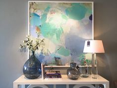 Add brightly colored art into your room to give it a pulse.