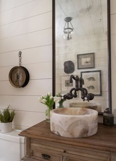 Sean Anderson Design | incredible stone sink and antique glass mirror. Beautiful mixed textures of stone, wood and metal pipe
