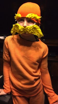 Lorax costume from a fleece blanket, orange toboggan and yellow yarn.