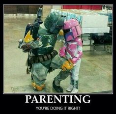 Parenting: You're Doing It Right   Adult in green Mandolorian armor, like Bob's Getting, and a child in pink Mandolorian armor.