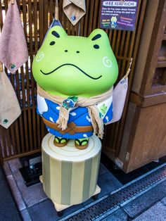 """The people of Edo had a fondness for frogs so """"Koike"""", one of the many souvenir shops in Asakusa's bustling Nakamise Dori, proposes one of them, """"Kero-kichi"""" as a good luck mascot; he is of course dressed as an Edokko (son of Edo) and he is featured on many of the shop's signature goods. #Asakusa, #Koike, #frog, #Nakamise, #Kerokichi February 2, 2015 © Grigoris A. Miliaresis"""
