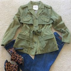 """{Anthropologie} Ruffleback Anorak {Anthropologie} Ruffleback Anorak by Hei Hei. 'We're always on the lookout for of the moment updates to our standard wardrobe staples, like this crisp anorak by Hei Hei, which makes a ladylike exit over denim and dresses alike.' Supe cute army green color, belted with ruffling in the back. Lots of pockets, button front. 100% cotton. Approx 26"""" long. Size Small. NWT, never worn. Anthropologie Jackets & Coats"""