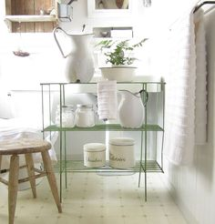 Love the pop of green with the vintage wire shelf, and cottage touch with the old milking stool. Vintage Green, Vintage Metal, Free Standing Shelves, Vintage Bookcase, Milking Stool, Metal Rack, Prop Styling, Wire Shelving, Beautiful Bathrooms