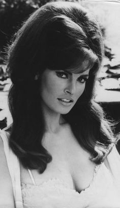 raquel welch modeling an awesome 60's bouffant. *beautiful, I can't wait to have long enough hair for that style*