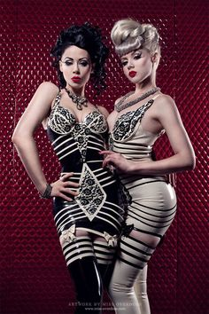 Wish these lovely ladies would let me help them dress/undress..... Love latex