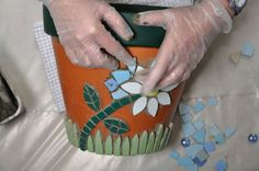 Here is my step-by-step guide to show you how I created this cheerful, summery mosaic flower pot for the garden. You can also buy a kit to help you to make your own! You will need: MATERIALS Plai… Mosaic Planters, Mosaic Vase, Mosaic Flower Pots, Terracotta Flower Pots, Mosaic Garden, Mosaic Tiles, Mosaics, Flower Pot Crafts, Clay Pot Crafts