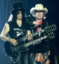 Guns N' Roses founders (from left) Slash and Axl Rose, open their Not In This Lifetime Tour on Thursday night, June 23, at Detroit's Ford Field.