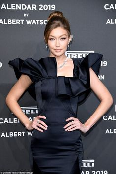 Gigi Hadid oozes timeless glamour in a ruffled black satin gown as she attends Pirelli Calendar launch in Milan Gigi Hadid Walk, Bella Gigi Hadid, Glamour, Sparkly Jumpsuit, Modelos Fashion, Img Models, Satin Gown, Dior Couture, Edgy Look