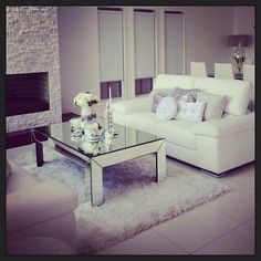 Shag pile rug texture + mirrored reflective table and decorative elements making it personal. Sofa no bueno.
