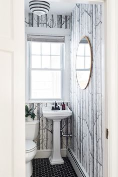 powder room with woods wallpaper design