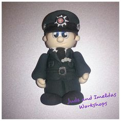 Dinky little psni officer made in clay