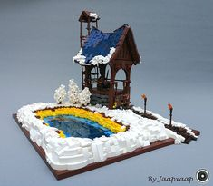 This guard post protecting a hot spring, built by Jaap Bijl, looks like the prime place for guard duty on a cold winter day! Lego Winter, Lego Display, Lego Craft, Lego Castle, All Lego, Lego Worlds, Lego Photography, Lego Architecture, Lego Creator