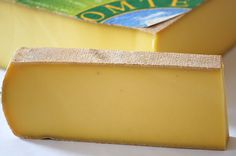 Comte-Artisanal Premium Cheese    Like a super duper mild gouda.  Sweet, buttery, and nutty. #cheese