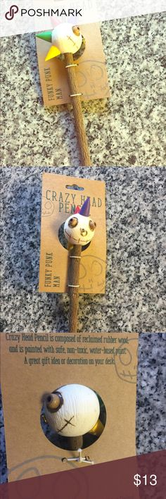 Crazy head 100% Tree pencil ✏️ Going back to school? This pencil is unique as they come.  Craved from a tree, bark is on outside of pencil with real wooden head! Funky Punk Man Accessories
