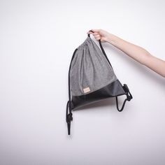 drawstring bag, faux leather (perhaps supply brown faux leather) base