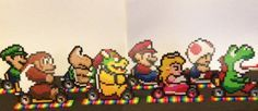 Super Mario Kart Bead Sprites by ThePixelizedPrincess on Etsy. Luigi, Donkey Kong, Koopa Troopa, Bowser, Mario, Princess Peach, Toad, and Yoshi - all based on the Super Nintendo game and come on the Rainbow Road track.
