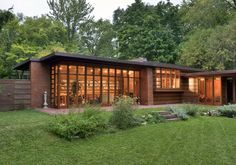 Herbert and Katherine Jacobs House (1936, Madison, Wisconsin). This brick and wood abode, built affordably for a family, is an example of indoor-outdoor living—a wall of full-height glazed doors open onto a terrace.