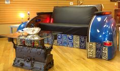 Engine Block Table with 1950 Plymouth Couch - this is just too cool and great for a man cave.  www.highroadorganizers.com