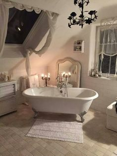 Romantic, shabby chic bathroom with a country look. Roll top bath, beautiful taps and mirror leaning against the wall. The candles add a romantic element. If you like this pin, why not head on over to get similar inspiration and join our FREE home design resource library at http://www.FlorenceAndFreya.com?