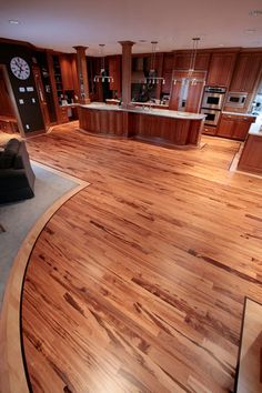 Originally This Floor Was Entirely Maple Flooring And The Homeowner Wanted  4u2033 Tigerwood In The