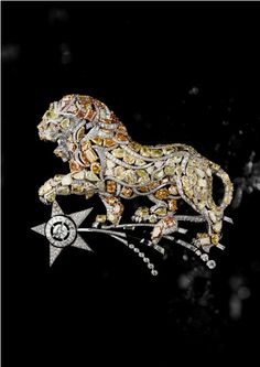CHANEL lion brooch. The lion became one of Chanel's iconic symbols because CoCo was a leo.
