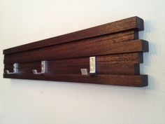 Custom Simple Interior Decoration with Walnut Wood Wall Mounted Coat Rack with Shelf and Salvage Wood Wall Shelving Decor. Three Aluminum Coat Hooks and Dark Wood Block Wall Panels