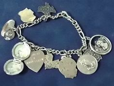 FOR SALE IS THIS LOVELY .925 STERLING SILVER CHARM BRACELET WITH 12 STERLING SILVER CHARMS. THE CHARMS INCLUDE THOMAS JEFFERSON/ MONTICELLO; SERENITY PRAYER MEDALLION; PICTURE LOCKET; TWO CHILD HEADS; DOMED STADIUM, HOUSTON; HEART; COWBOY HAT; ...
