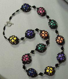 Netted bead necklace - netting over painted wooden beads.   Forget the glue.  Make these over glass beads.  #Seed #Bead #Tutorials