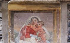 Madonna and child.  Painted on an outdoor wall in Torno, Italy, a village on the Lake of Como.  Photo by Susan Pogany.