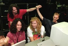 The world lost superstar musicians, stars of stage and screen, authors, photographers, astronauts, athletes, and larger-than-life political figures in 2016. / Nick Menza with Megadeth members in 1997