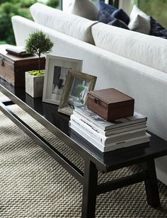 bench behind sofa. Stockholm Vitt. I like the color and accents, husband will think its too cluttered