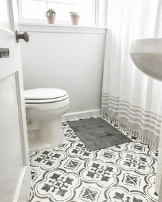 Bathroom Remodel Inexpensive bathroom remodel with stenciled tile floors from Cutting Edge Stenci. Inexpensive bathroom remodel with stenciled tile floors from Cutting Edge Stencils Inexpensive Bathroom Remodel, Half Bathroom Remodel, Shower Remodel, Bathroom Renovations, Bathroom Makeovers, Stenciled Tile Floor, Bathroom Floor Tiles, Floor Stencil, Kitchen Tile