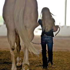 Love....her beautiful hair matches the horse perfectly
