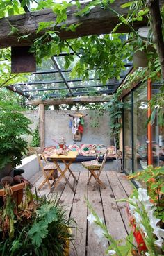 Boho Patio | Bohemian Outdoor Living love the black framed glass roof atop old…