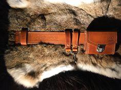Handmade Equipmentbelt with an axeholder.