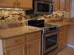mosiac tile backsplash | ... Kitchen Backsplash Pictures vine mosaic tile backsplash – Decozilla.. interesting...nice colors and uneven tiles.. vine would be too much for our kitchen.. maybe just behind stove top