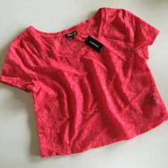 "Express pink lace crop top Brand new with tags, this is a gorgeous vibrant coral pink. Measures 16.5"" from underarm to underarm and 17"" long. Express Tops Crop Tops"