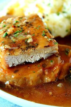 Instant pot smothered pork chops recipe saucy pork chops cooked in the instant pot with onion mushrooms gravy perfect easy recipe with boneless chops served with mashed potatoes and roasted veggies biscuit chicken pot pie Braised Pork Chops, Smothered Pork Chops Recipe, Boneless Pork Loin Chops, Juicy Pork Chops, Pork Chops And Potatoes, Mashed Potatoes, Instapot Pork Chops, Instant Pot Dinner Recipes, Recipes Dinner