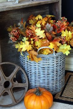 fall front porch- spray a goodwill basket blue & add $ store leaf branches.