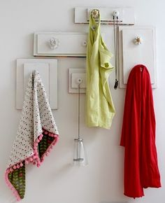 Instead of the usual hooks in a row build your own clothes hanger using wood pieces and unique knobs.  Would be cute to use coordinating fabrics modpodged onto the wood as well.