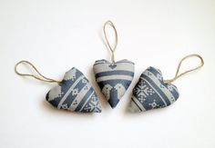 Set of 3 hearts in Scandinavian style print on grey cotton fabric, each on a jute twine hanger - in my Etsy shop.