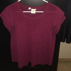 Maroon blouse Maroon blouse with gold jewels all over the front. Size large. Worn only a handful of time. Firm on price Tops Blouses