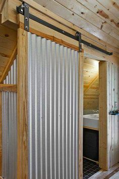 Love an industrial, rustic or even modern look? Then give corrugated metal decor a try! Check out all these ways to use corrugated metal in home decor. Attic Apartment, Apartment Interior, Studio Apartment, Apartment Design, Apartment Therapy, The Doors, Sliding Doors, Small Doors, Entry Doors